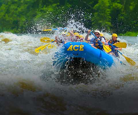A group of rafters run fayette station rapid on the new river with ace adventure resort.