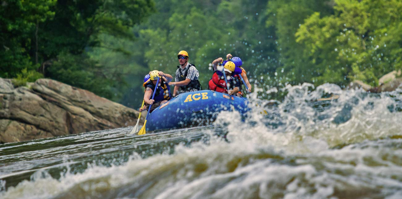 Rafters approach a rapid in the spring rafting on the new river gorge with ace adventure resort.