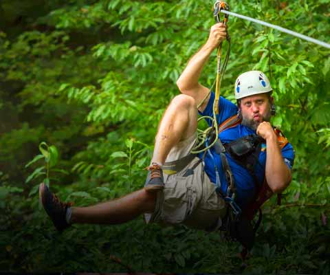 A zipline guide at ACE Adventure Resort goofs off for the camera.