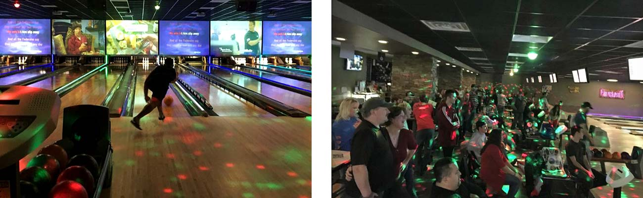 Bowling a strike with a group of bowlers watching at Pinheads.
