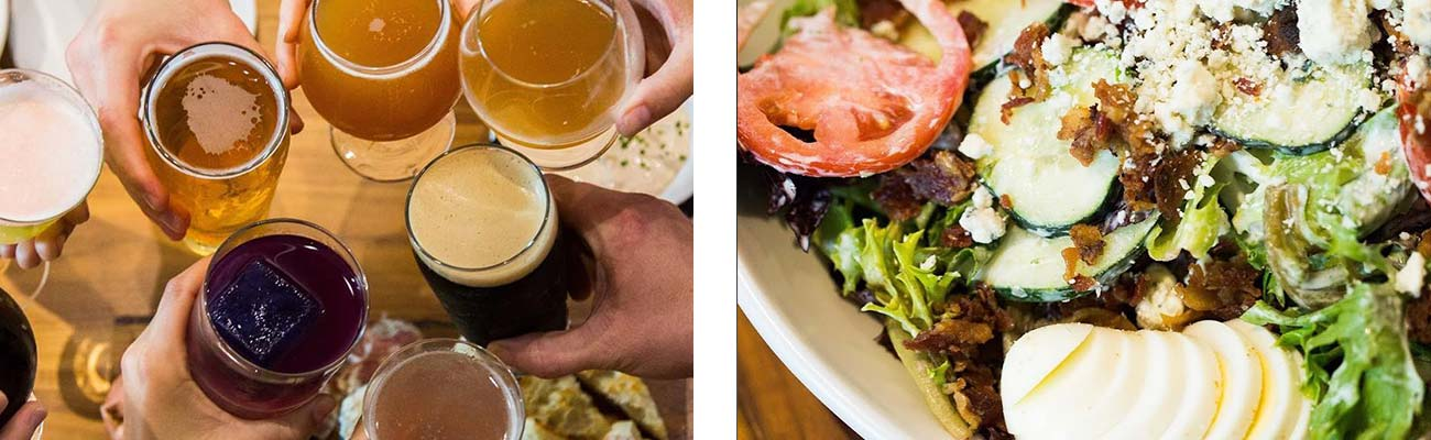 Friends toasting an assortment of beers in pint glasses with a salad from Secret Sandwich Society Fayetteville.