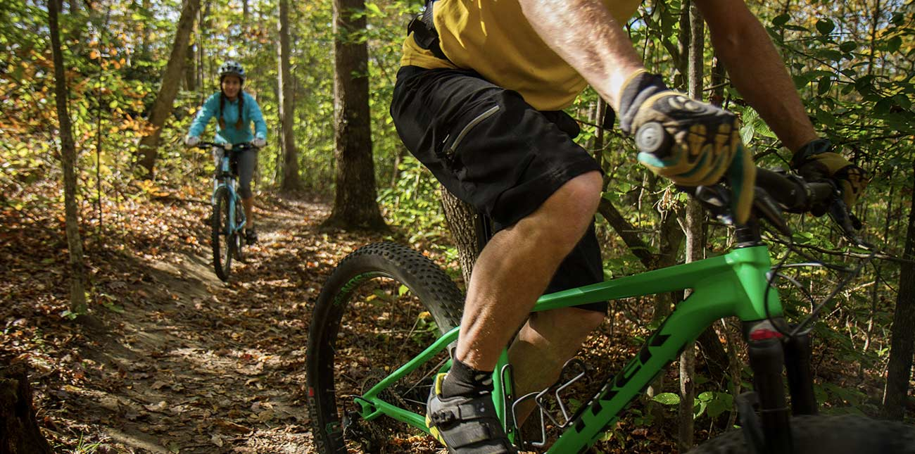 Mountain bikers ride single track trails on a guided bike tour at Arrowhead Trails in Fayetteville, West Virginia.