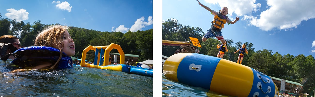 A kid jumps off a floating trampoline into ACE Lake at West Virginia family resorts Wonderland Waterpark at ACE Adventure Resort.