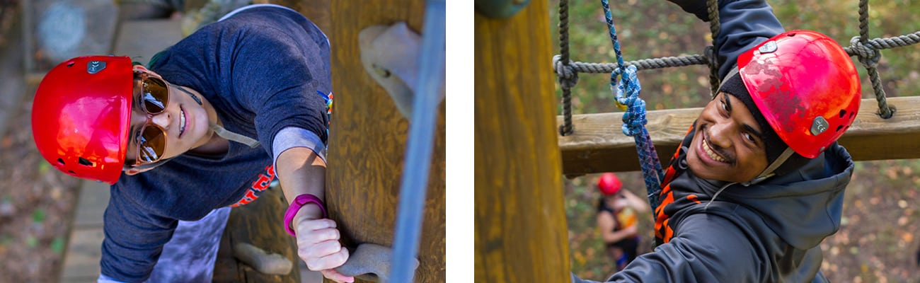 Two college students from University of Charleston climb up the Ropes Challenge Course during a team building West Virginia Adventure at ACE Adventure Resort.