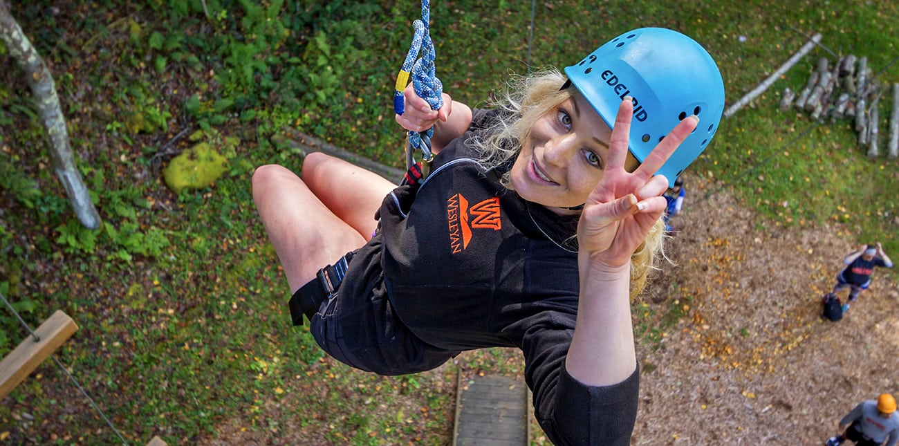 A student rappels down the Alpine Tower at the Team Challenge Course at ACE Adventure Resort in West Virginia.