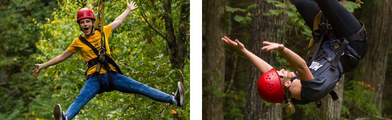 Two friends fly through the air on gravity zip lines at ACE Adventure Resort.