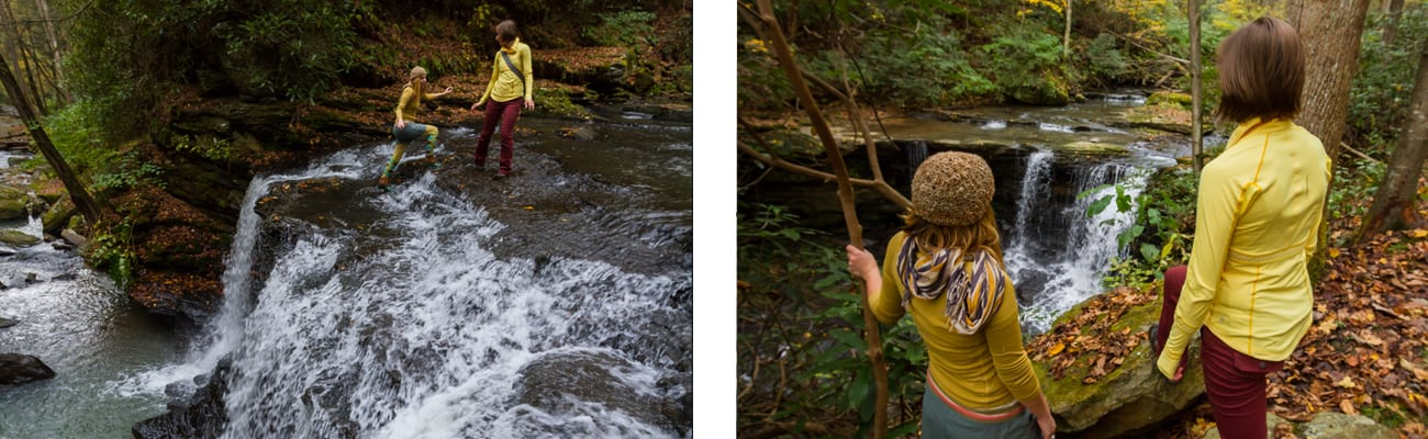 Two women hike through native plants and waterfalls along a trail at ACE Adventure Resort in West Virginia.