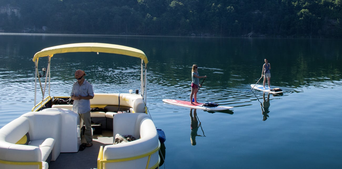 West Virginia resorts offer stand up paddle boarding and SUP lessons on Summersville Lake with pontoon boat.