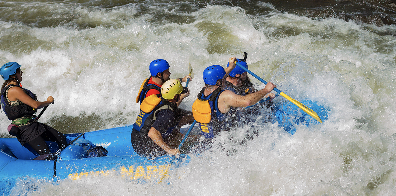 Paddling class V whitewater rapids on an Upper Gauley river rafting trip with ACE Adventure Resort.