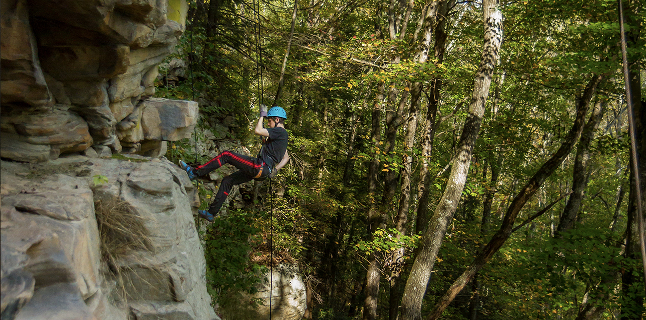Rappelling and rock climbing on ACE Adventure Resort's private property climbing area in Oak Hill, West Virginia.