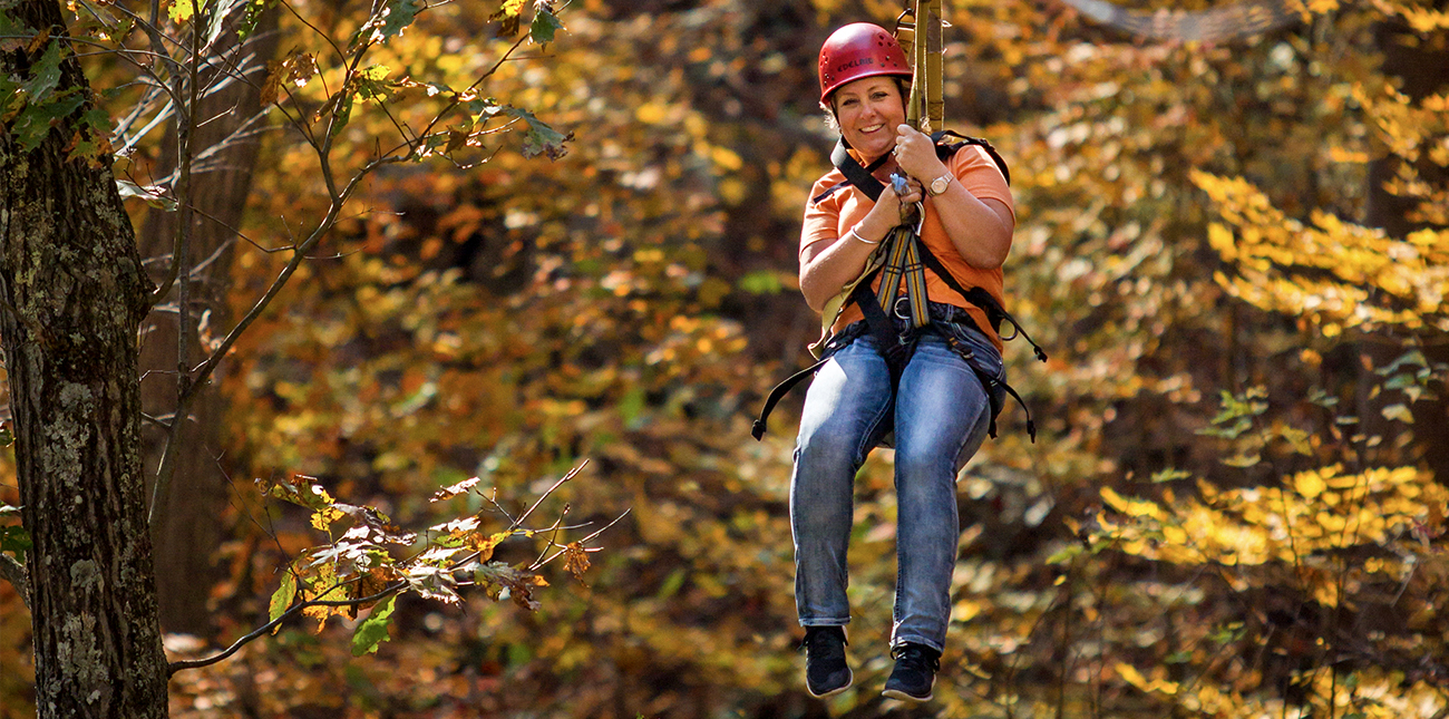 Fall zip lining in WV on a guided tour with ACE Adventure Resort in Oak Hill, West Virginia.