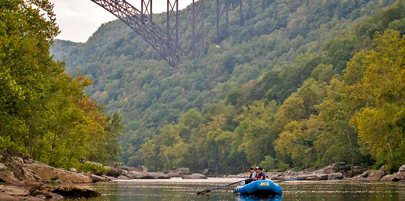 New River fishing in an oar boat under the New River Bridge with ACE Adventure Resort in West Virginia.