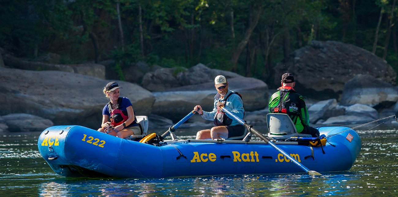 An oar boat takes guests on a guided fishing tour of the New River with ACE Adventure Resort in the New River Gorge in West Virginia.