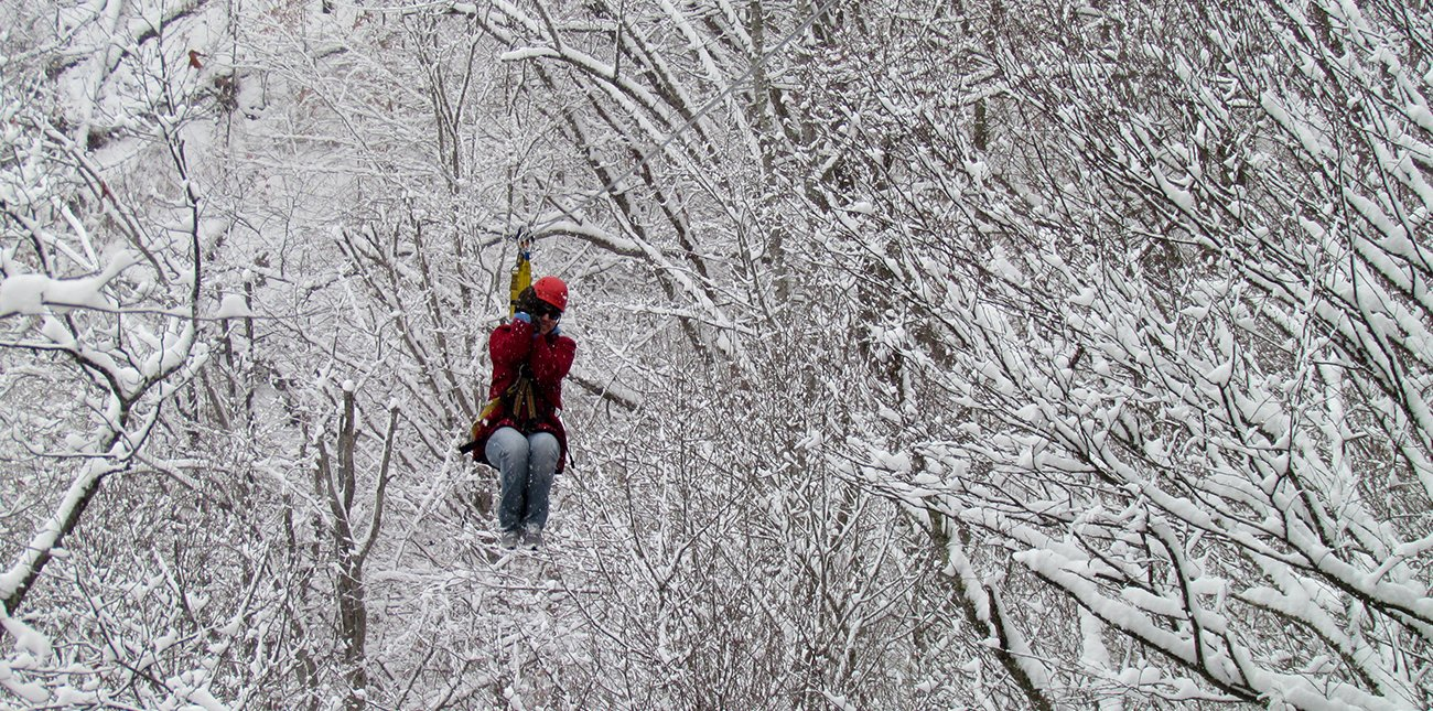 Winter zip lining after a fresh snowfall in the New River Gorge at ACE Adventure Resort in Oak Hill, WV.