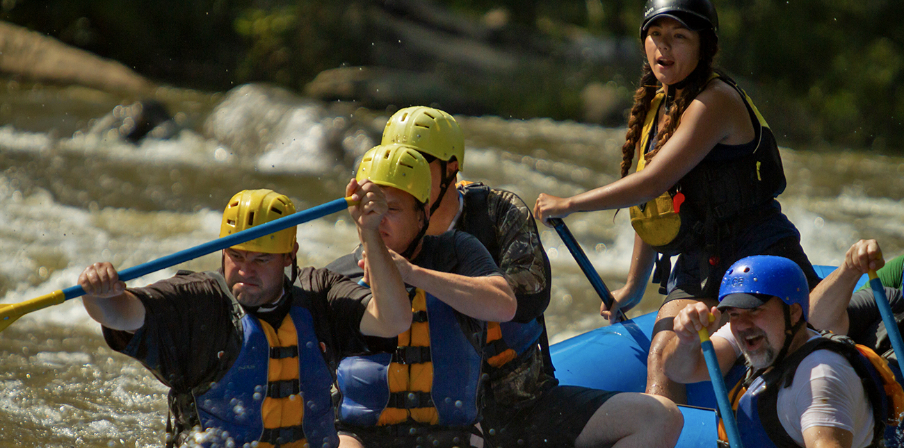 Sam Hood guides her raft through Lower Mash on the Upper Gauley River in West Virginia.