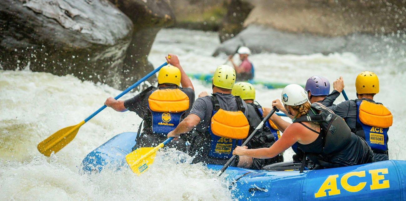 Raft guide Jenn Sapio lines up at Pillow Rock, a Class V rapid on the Upper Gauley River on a rafting trip with ACE Adventure Resort in West Virginia.