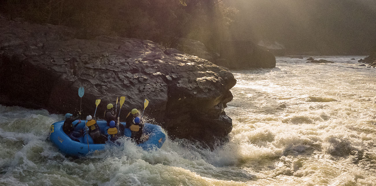 Smacking paddles on Pillow Rock Class V rapid on the Upper Gauley River with ACE Adventure Resort.