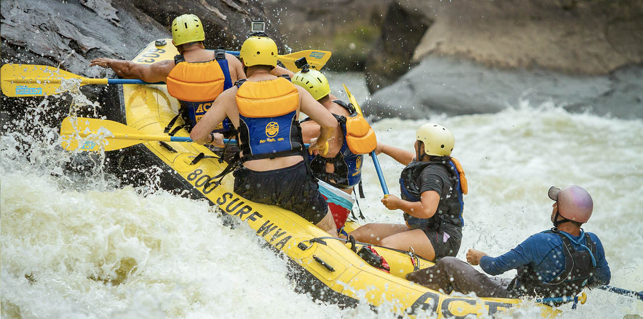 ACE Adventure Resort raft guide Josh Sapio on the Upper Gauley River at a class V rapid.