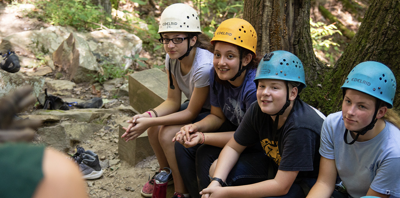 A group of STEM students study geology with rock climbing in ACE Adventure Resort's outdoor classroom in the New River Gorge.
