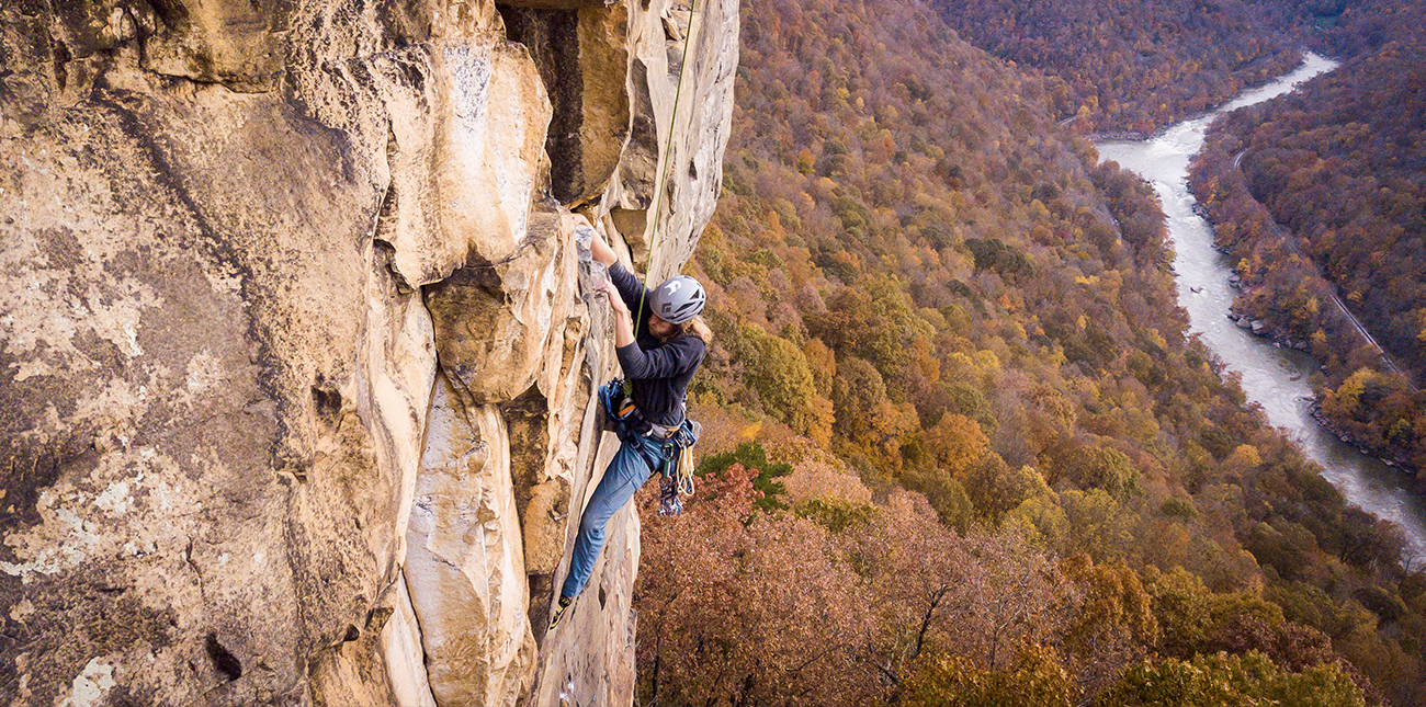 Using top rope to climb the hard sandstone walls of the New River Gorge in West Virginia.