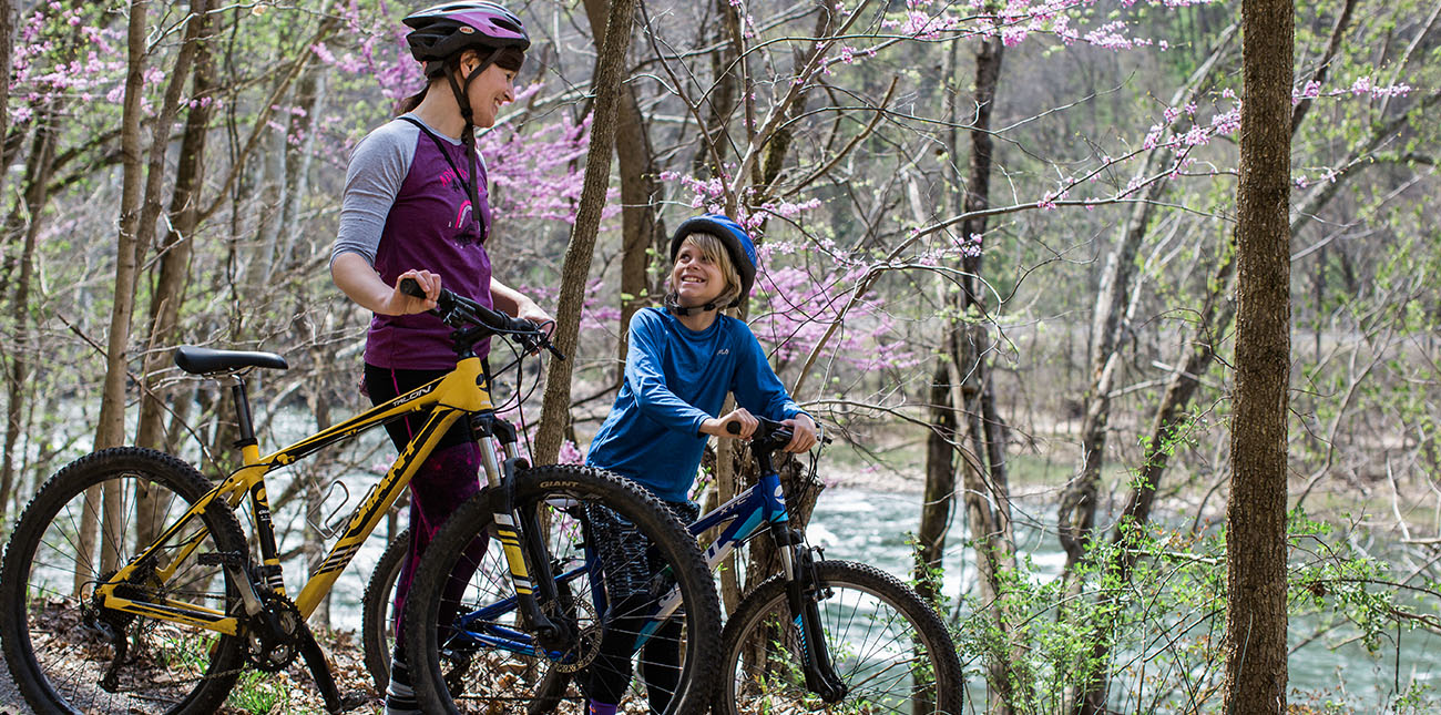 A mountain biking family rides the New River Gorge Southside Trail with ACE Adventure Resort.