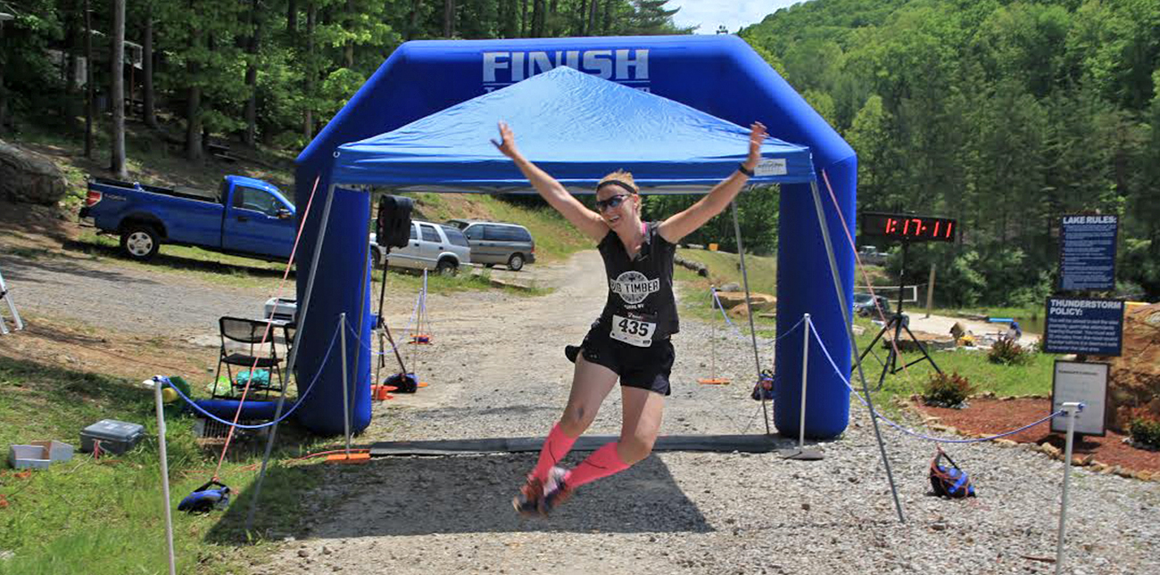 A runner crosses the finish line at the Wonderland Mountain Challenge at ACE Adventure Resort in Southern West Virginia.