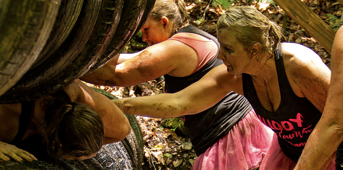 Gritty Chix athletes tackle the tires during the 2018 Gritty Chix Mud Run at ACE Adventure Resort in Southern West Virginia.