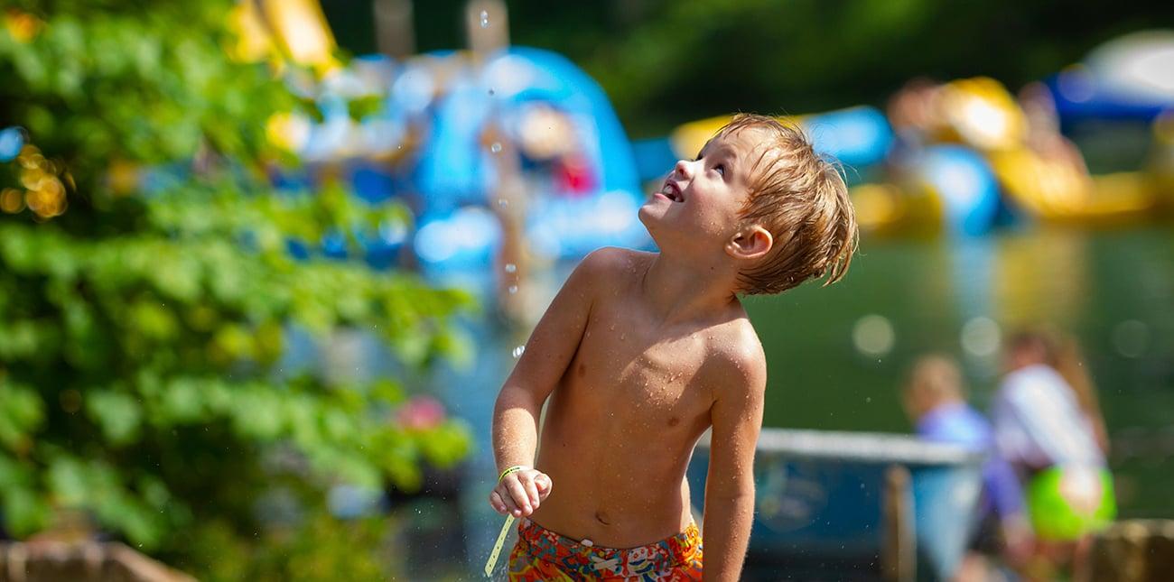 Playing on the splash pad at Wonderland Waterpark at ACE Adventure Resort.