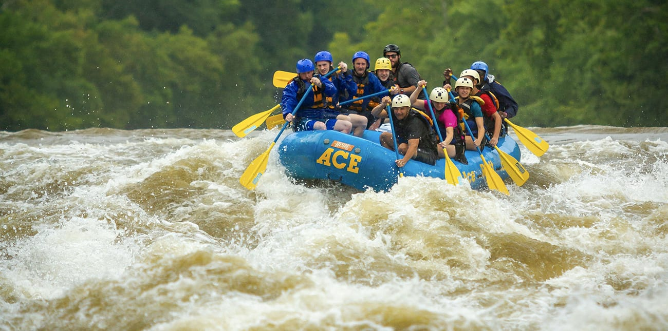 Spring rafting on the Lower New River with ACE Adventure Resort in the New River Gorge below on Fayette Station rapid.