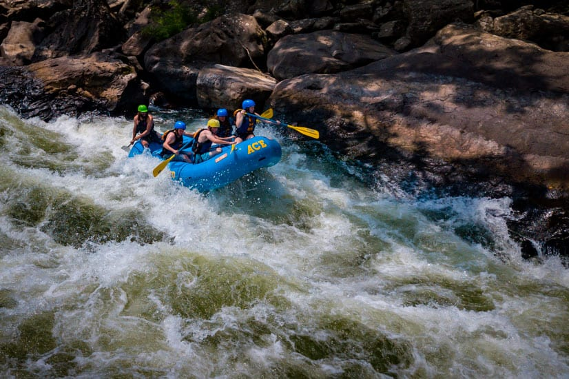 New River Gorge rafting guests paddling through Lower Keeney Rapid with ACE Adventure Resort.