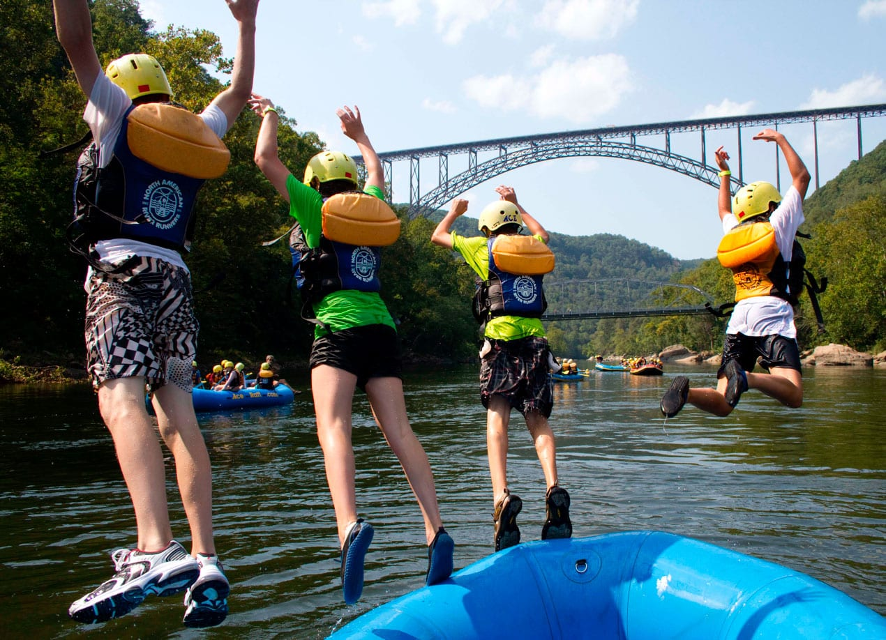a youth group adventures by jumping from their raft into the river