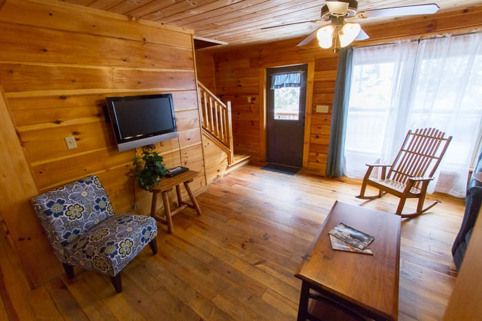 An interior shot of a deluxe cabin's den from one of ACE Adventure Resort's New River Gorge, West Virginia cabin rentals.