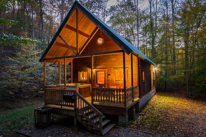 An illuminated night view of the Aspen Log home one of ACE's new river gorge vacation home rentals
