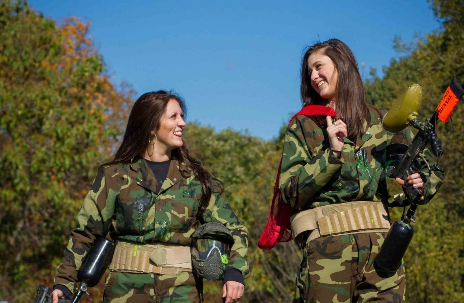 Two women exit the paintball course after a game at ACE Adventure Resort.