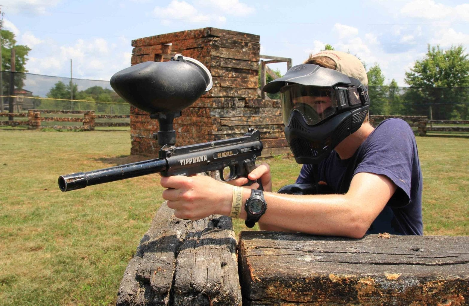 An older kid aims his paintball gun on the mountaintop course at ACE Adventure Resort.