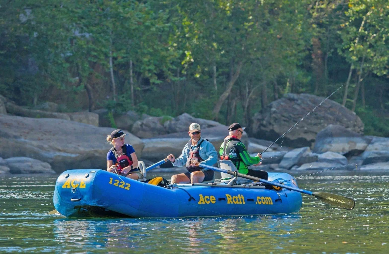 A group fishes from a raft on the Lower New River on a guided fishing tour with ACE Adventure Resort