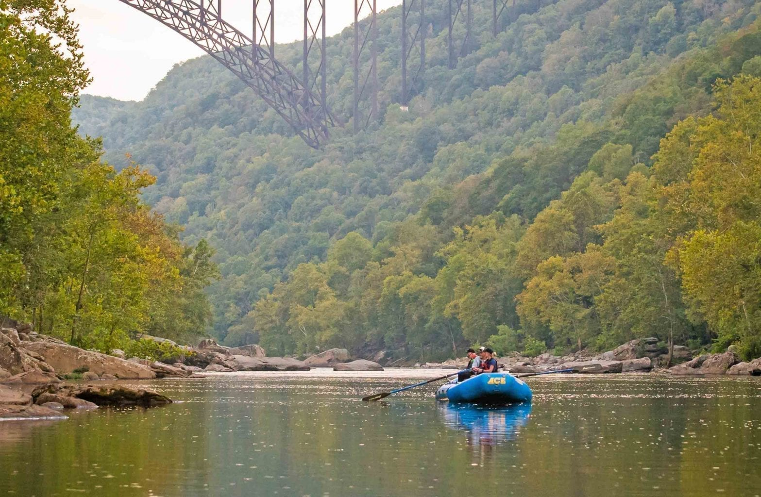 Float fishing from an oar raft on a guided fishing trip under the New River Gorge Bridge with ACE Adventure Resort