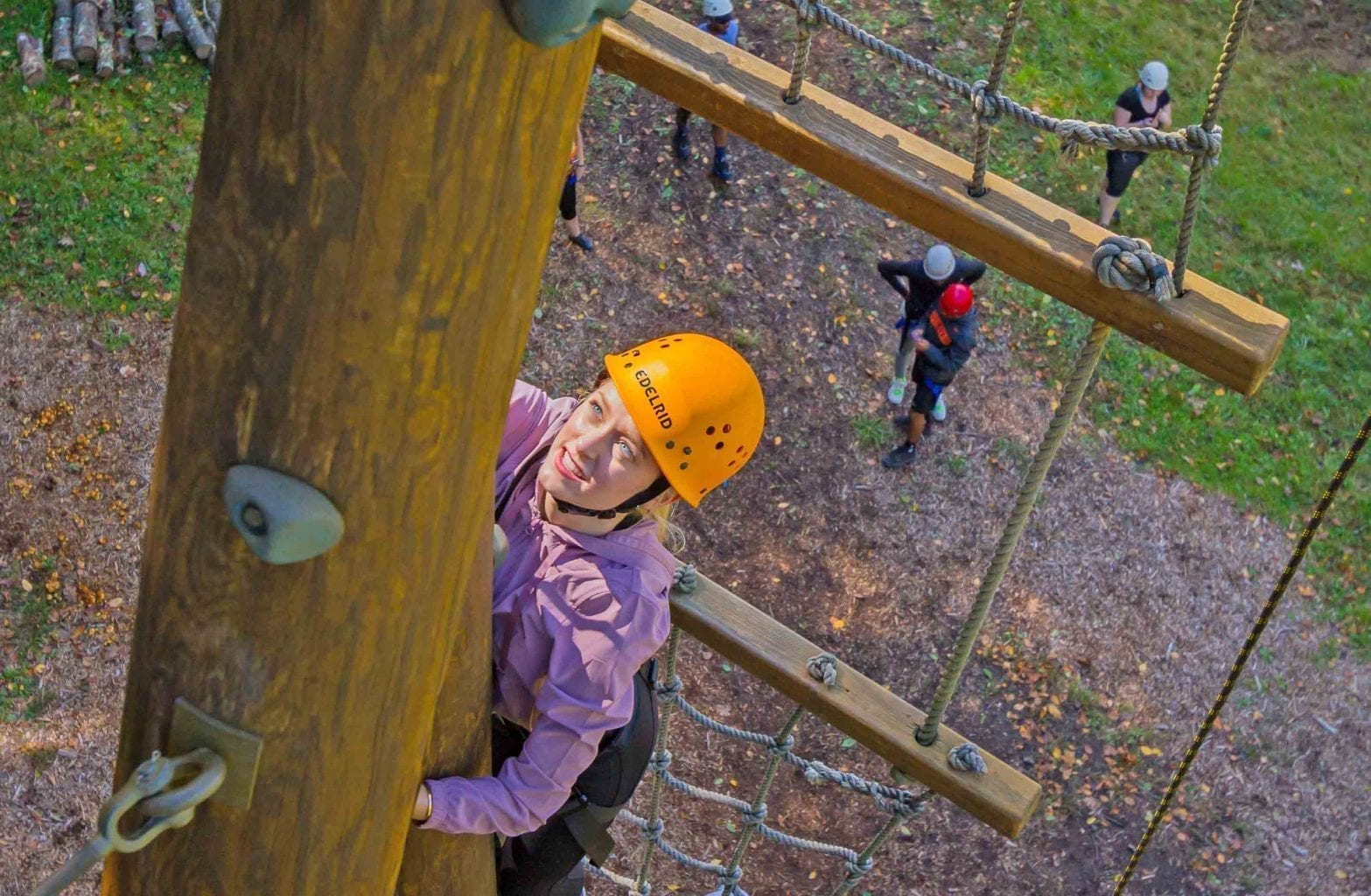 A girl climbs the tower on the Team Challenge Course on a half day trip with ACE Adventure Resort