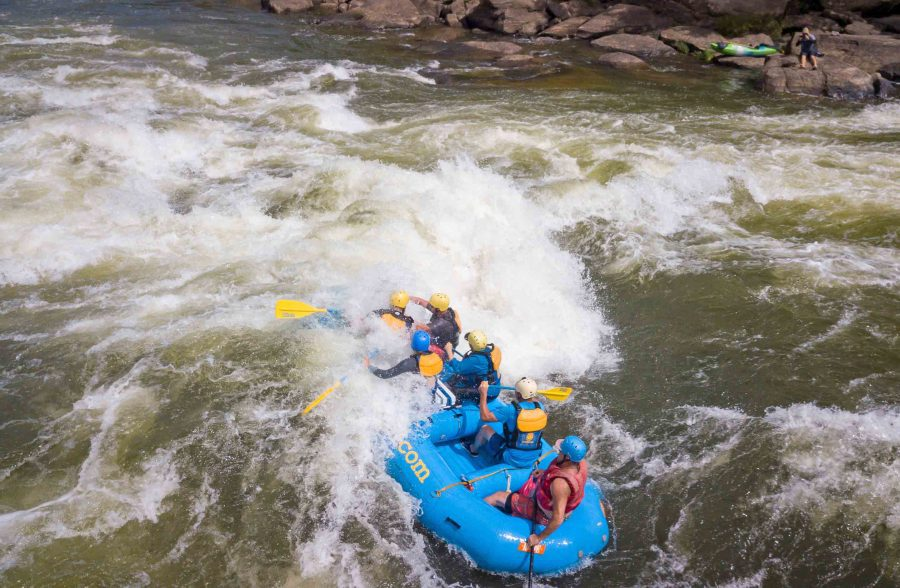 ACE guests paddle their raft through rapids on the Lower New River.