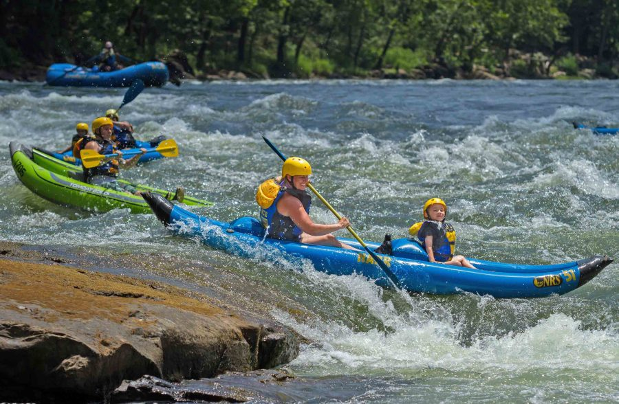 Kids and parents kayak together on the Upper New River with ACE Adventure Resort.