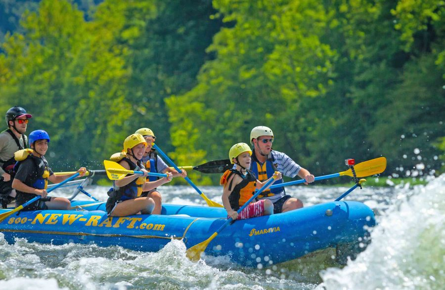 A family paddles the Upper New River with ACE Adventure Resort.