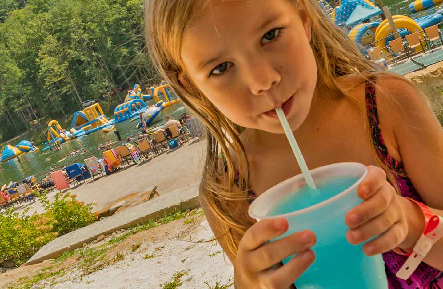 Photo of a Young Girl Sipping on a Slurpie at Our Family Adventure Resort.