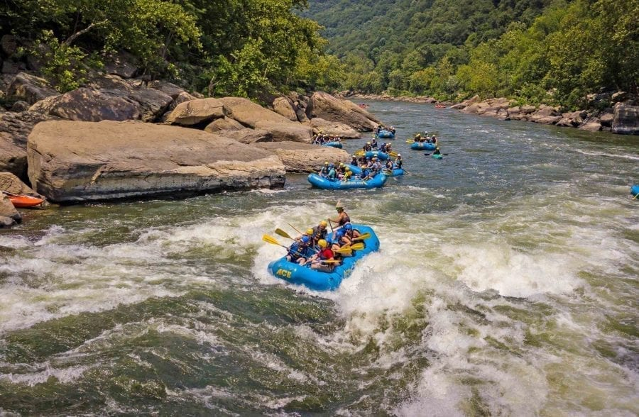 An ACE raft paddle the Lower New River on a white water rafting trip through the New River Gorge, West Virginia.