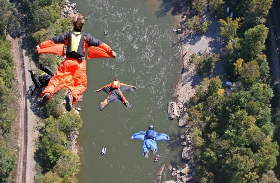 BASE jumpers leap from the New River Gorge Bridge on Bridge Day in Fayetteville, West Virginia.