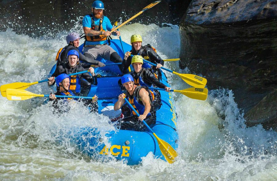 Rafting Pillow Rock rapid on the Upper Gauley RIver on a guided white water tour with ACE.