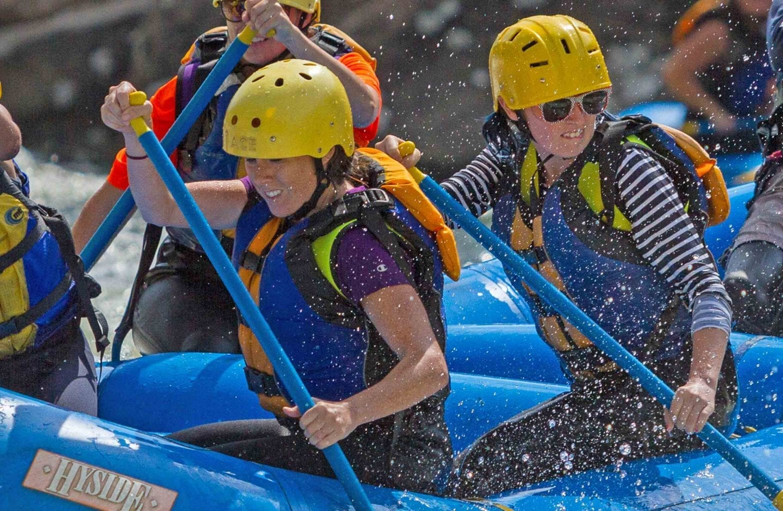 Girls paddle the Gauley River on a guided white water rafting trip with ACE Adventure Resort.