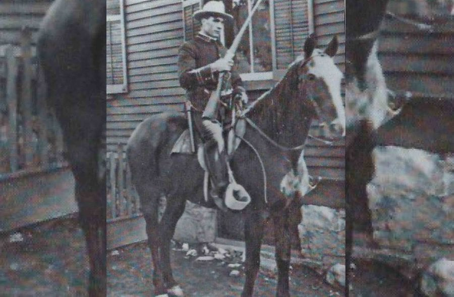 An armed mine guard in a historical photograph from archives in Thurmond, West Virginia.