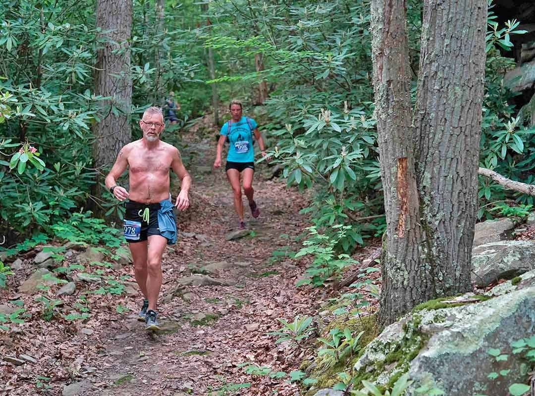 Runner in Woods with Rocks