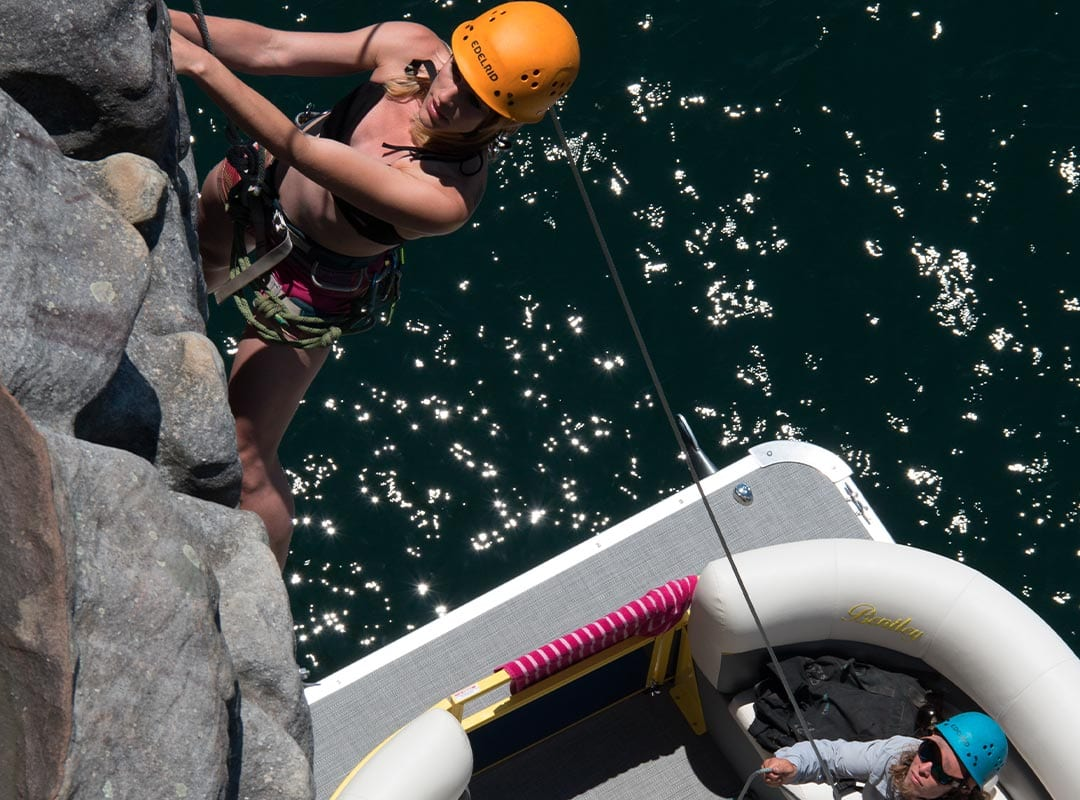 girl climbing above boat