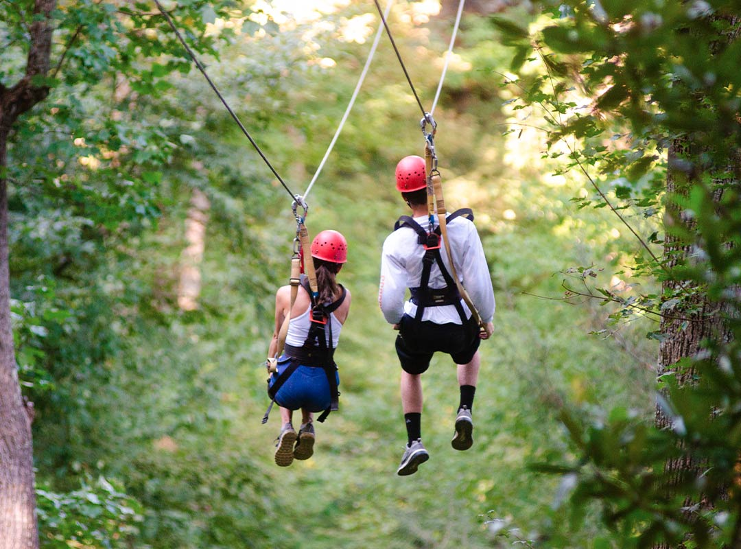 Couple ziplining